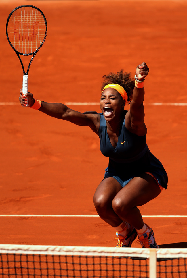 Serena reacts after winning the French Open