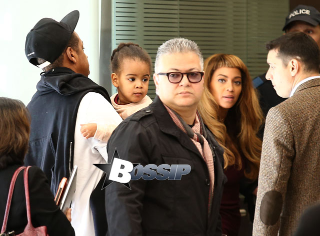 Singer Beyonce Knowles, her husband Jay-Z and their daughter Blue Ivy catch a flight out of Gare du Nord airport on October 14, 2014